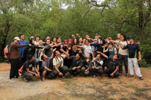 Bootcampers posing with local women leaders of PIWANITA and the special berembang jam they produce from mangrove species.