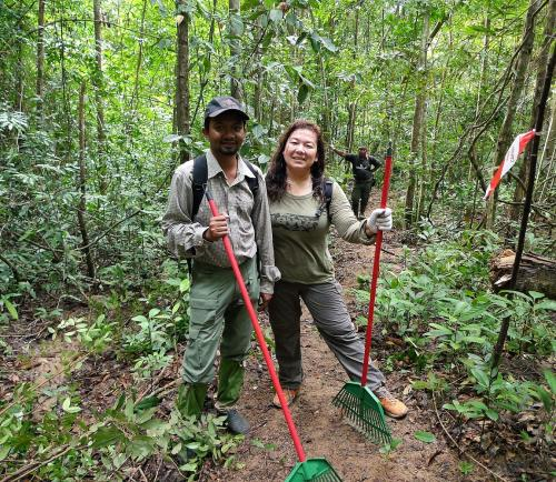 Justine Vaz of The Habitat Foundation and Ahmad Zafir of The Habitat Penang Hill join in the building of the new trail.